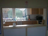<h5>Scout Hall</h5><p>The view into the kitchen through the hatch</p>